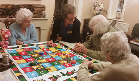 residents playing snakes and ladders